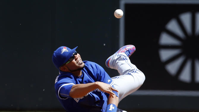 Toronto Blue Jays first baseman Edwin Encarnacion throws to pitcher Aaron Sanchez for the out after fielding a grounder by Minnesota Twins' Joe Mauer in the sixth inning of a baseball game, Saturday, May 30, 2015, in Minneapolis. The Twin won 3-2. (AP Photo/Jim Mone)