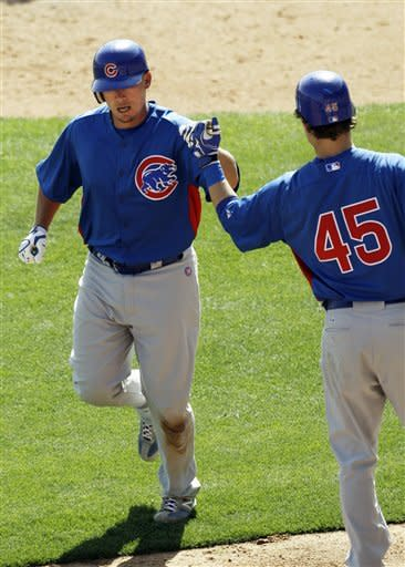 Wood pitches into third inning for Cubs in win