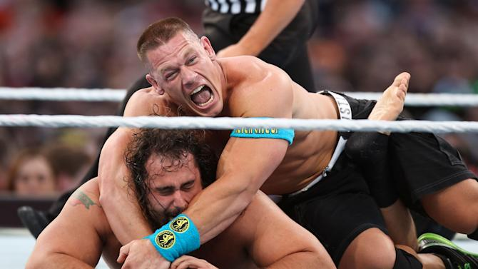 WWE wrestler John Cena holds opponent Rusev at Wrestlemania XXXI, on Sunday, March 29, 2015 in Santa Clara, CA. 2015 marks the first year Wrestlemania will be held in the San Francisco Bay Area, being made available to viewers in 177 countries via the WWE Network. (Don Feria/AP Images for WWE)