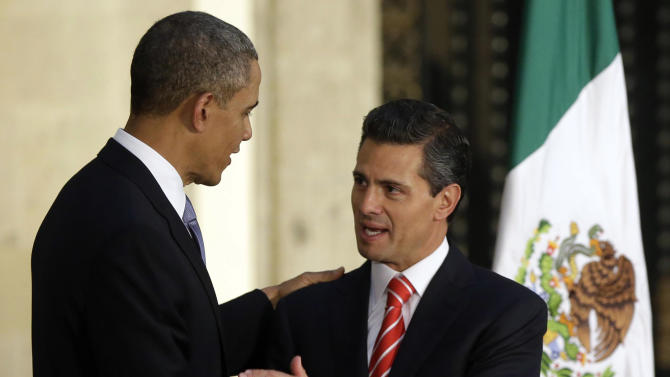 President Barack Obama, left, and Mexico's President Enrique Pena Nieto, right, shake hands following their news conference at the Palacio Nacional in Mexico City, Thursday, May 2, 2013. (AP Photo/Pablo Martinez Monsivais)