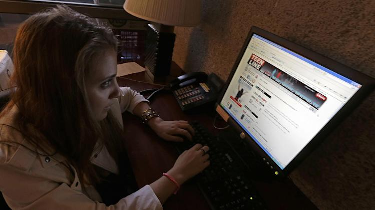 In this Tuesday, March 26, 2013 photo, Volunteer Sophia (last names not given) views the home page of the Teen Line center, that takes text messages and phone calls from teens seeking help, at Cedars Sinai Medical Center in Los Angeles. As more teens have gone mobile, using their phones as an extension of themselves, hotline providers have tried to keep up.  Some text providers operate in specific towns, counties or regions and-or rely on trained teen volunteers to handle the load across modes of communication.(AP Photo/Reed Saxon)