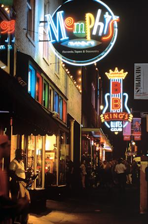 FILE - In this undated file photo provided by the Memphis Convention & Visitors Bureau shows Beale Street in Memphis at night. A stroll along Beale Street, home to blues bars, barbecue restaurants, gift shops and dance clubs with a long history of influencing American music, is one of the top tourist attractions in Memphis.   (AP Photo/Memphis Convention & Visitors Bureau, file)