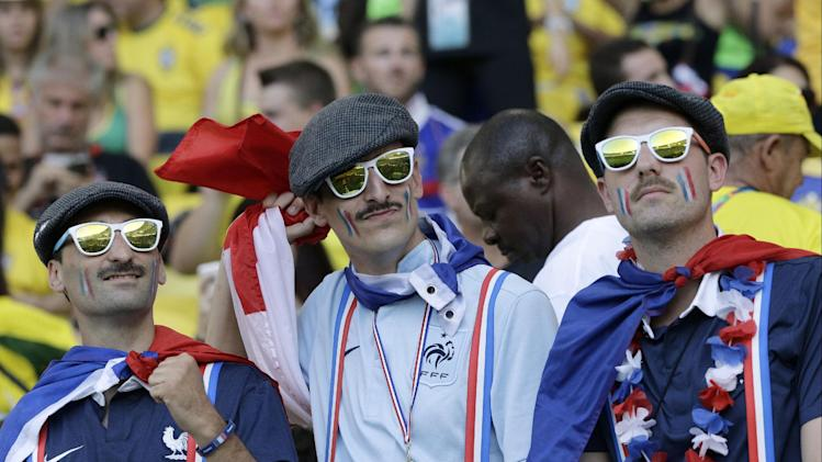 France fans wait for the beginning of the group E World Cup soccer match between Ecuador and France at the Maracana Stadium in Rio de Janeiro, Brazil, Wednesday, June 25, 2014