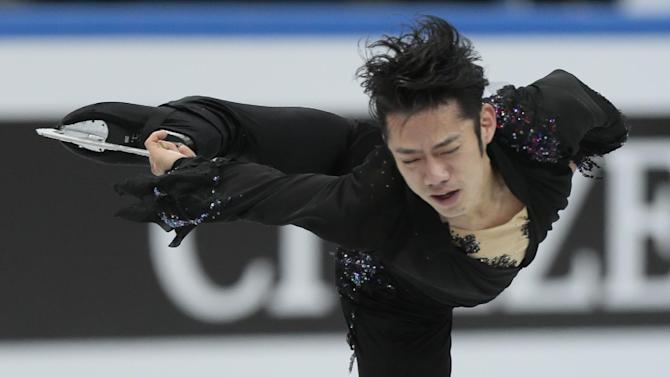 Takahashi Daisuke, of Japan, skates his free program to win the gold at the ISU figure skating Grand Prix Final event, at Iceberg stadium in Sochi, Russia, on Saturday, Dec. 8, 2012. (AP Photo/Ivan Sekretarev)
