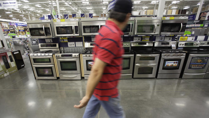 In this April 27, 2012, photo, a customer walks by and looks at kitchen appliances at a Lowe's store in Dallas. Orders for durable goods increased a slight 0.2 per cent last month after a 3.7 per cent decline in March, the Commerce Department said Thursday, May 24, 2012. (AP Photo/LM Otero)