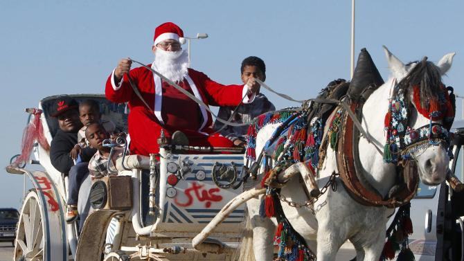 A man dressed as Santa Claus drives a horse cart during Christmas day in Sidon, South Lebanon