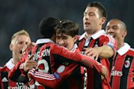 Urby Emanuelson (2nd L) and Bojan Krkic (C) of AC Milan celebrate after scoring a goal against FC Zenit St Petersburg during their UEFA Champions League group C football match in Saint-Petersburg . An own goal by Tomas Hubocan consigned Russian champions Zenit St Petersburg to a cruel 3-2 defeat in their Champions League group match with AC Milan here on Wednesday