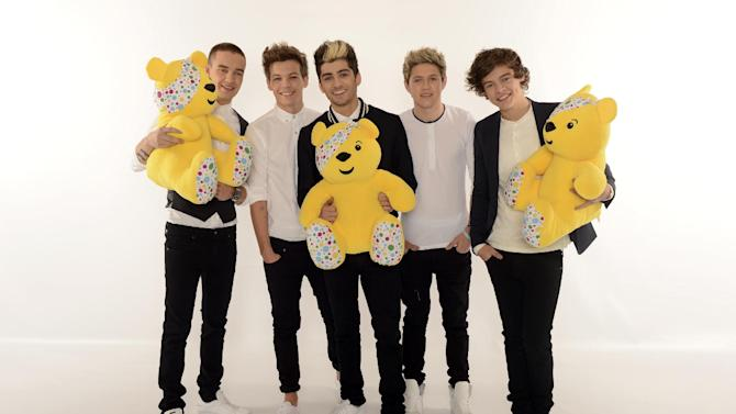Boy band One Direction, from left, Liam Payne, Louis Tomlinson, Zayn Malik, Niall Horan and Harry Styles are seen backstage at BBC's Children in Need at Television Centre on Friday, Nov. 16, 2012, in London. (Photo by Jon Furniss/Invision for Children in Need/AP Images)