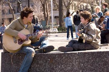Jonathan Rhys Meyers and Freddie Highmore in Warner Bros. Pictures' August Rush