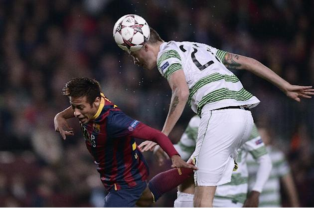 FC Barcelona's Neymar, left, duels for the ball against Celtic's Mikael Lustig during a Champions League soccer match group H at the Camp Nou in Barcelona, Spain, Wednesday, Dec. 11, 2013