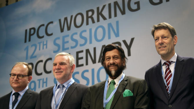 FILE - In this Monday, April 7, 2014 file photo Ottmar Edenhofer, Co-Chairman of the IPCC Working Group III, Jochen Flasbarth, State Secretary of the German Enviroment Ministry, Rejendra K. Pachauri, Chairman of the IPCC, and Jochen Schuette, State Secretary of the German Science Ministry, from left, pose for the media prior to a meeting of the Intergovernmental Panel on Climate Change, IPCC, in Berlin, Germany. After racing against the clock in an all-night session, the U.N.'s expert panel on climate change was putting the final touches Saturday, April 12, 2014, on a scientific guide to help governments, industries and regular people take action to stop global warming from reaching dangerous levels. (AP Photo/Michael Sohn, File)