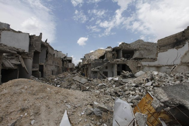 A view shows a deserted street piled with damaged buildings by what activists said was shelling by forces loyal to Syria's President Bashar al-Assad , in Al-Tarrab neighborhood near Aleppo Internation