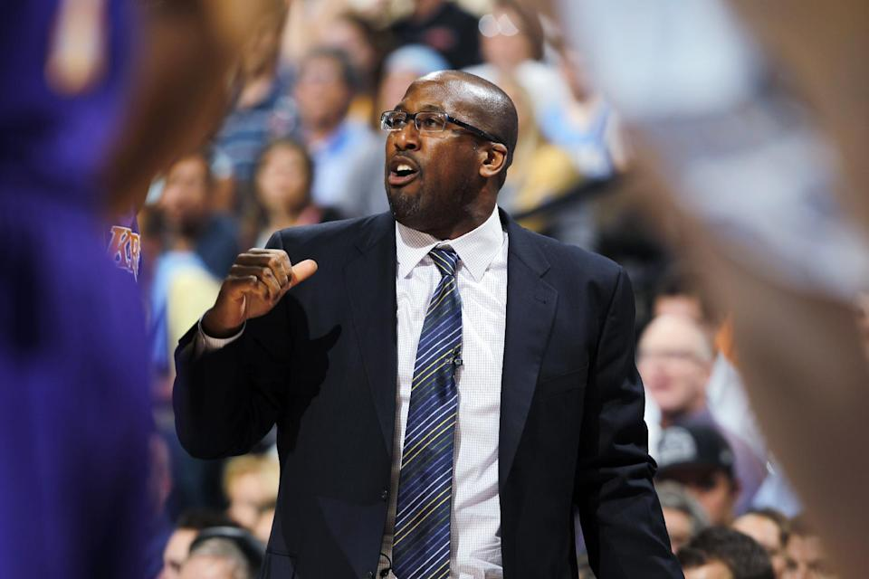 Los Angeles Lakers coach Mike Brown directs his team against the Denver Nuggets in the first quarter of Game 6 of a first-round NBA basketball playoff series in Denver on Thursday, May 10, 2012. (AP Photo/David Zalubowski)
