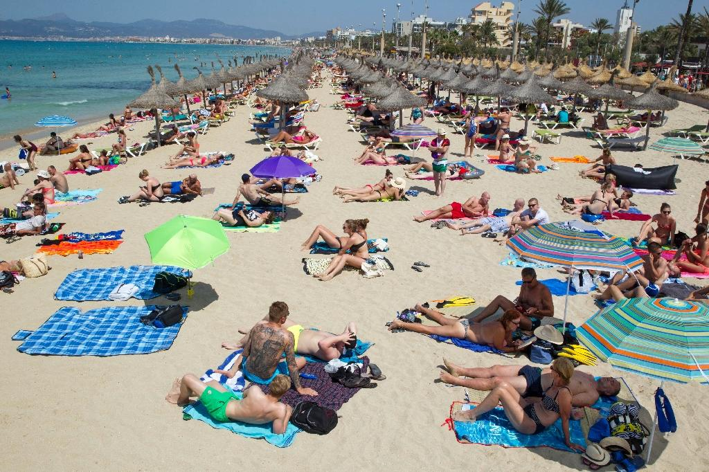 Fearful of attacks, tourists flood Spain's beaches