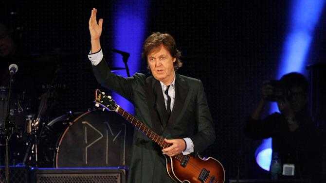 "FILE - This July 9, 2013 file photo shows Paul McCartney performing at Fenway Park in Boston, Mass. McCartney celebrated his 2-year wedding anniversary with his wife and few hundred students.The 71-year-old performed at the Frank Sinatra School of the Arts in the borough of Queens on Wednesday. McCartney said ""happy anniversary baby"" to Nancy Shevell before going into his latest song, ""New."" (Photo by Marc Andrew Deley/Invision/AP, File)"