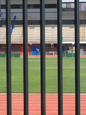 In this photo taken March 24 2013, shows Olympian athlete Oscar Pistorius running on the track at the University of Pretoria South Africa. The photo was taken by a pupil from the Voortrekker High School in Pietermaritzburg while on a hockey tour in Pretoria. A South African newspaper published the grainy cellphone image of Pistorius at a running track in his carbon fiber blades Thursday as the Olympian's agent said his return to training was now imminent, but denied he was already in training. (AP Photo/Lisa Smith)