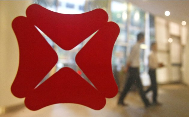 File photo of employees walking past a DBS Bank logo in the lobby of the bank's headquarters in Singapore