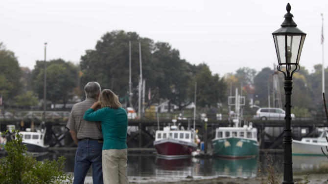 "This photo taken Oct. 5, 2012 shows independent voters Joe and Thyra Galli taking a break during their daily walk to watch fishermen, in Portsmouth, N.H. Thyra plans to vote for Obama and Joe is supporting Romney. New Hampshire's nickname is ""the Granite State"" but there's nothing solid about its political landscape. Independent voters have been the reason in recent presidential elections. Today, former factory towns to the south _ Manchester and Nashua _ typically vote Republican as do the rural small towns up north, while state capital Concord and university towns like Durham, Dover, Keene and Hanover tend to lean Democratic. And the entire state is peppered with independents like Joe and Thyra Galli of Portsmouth. (AP Photo/Robert F. Bukaty)"
