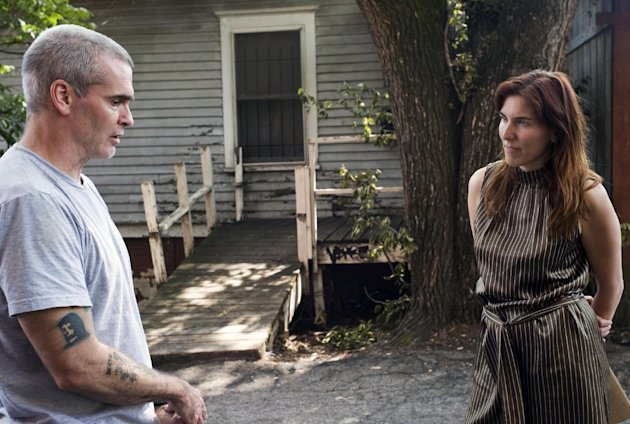 "This undated publicity photo released by Sony Pictures Classics shows Henry Rollins, left, and director Amy Berg in the documentary film, ""West of Memphis."" (AP Photo/Sony Pictures Classics, Olivia Fougeirol)"