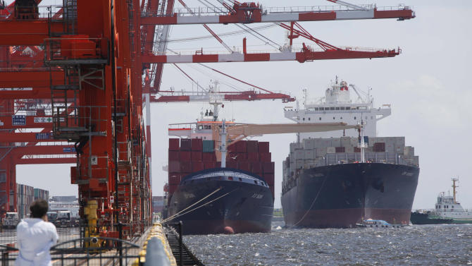 A container ship, right, arrives at a container terminal in Tokyo Monday, Aug. 13, 2012. Japan's economy grew at a slower-than-expected annualized rate of 1.4 percent in April-June, adding to worries over the global outlook, as consumer spending flagged following a rebound earlier in the year from last year's earthquake and tsunami disasters.  (AP Photo/Koji Sasahara)