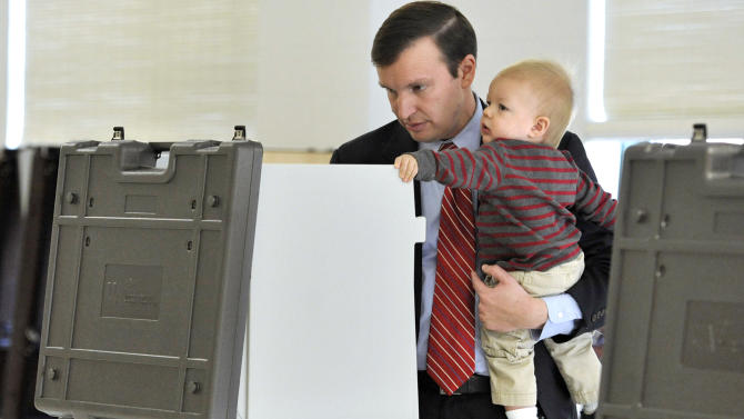 Democratic candidate for U.S. Senate Chris Murphy votes while holding son Rider in Cheshire, Conn., Tuesday, Nov. 6, 2012.  Murphy and Republican opponent Linda McMahon are vying for the Senate seat now held by Joe Lieberman, an independent who's retiring. (AP Photo/Jessica Hill)
