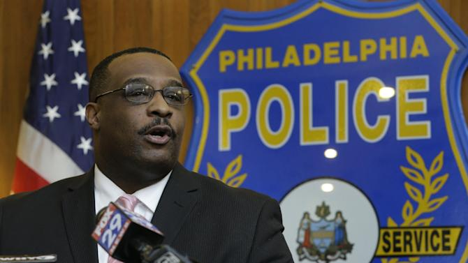 Homicide unit Capt. James Clark speaks during a news conference Thursday, Jan. 24, 2013, in Philadelphia. Clark says an exterminator, 36-year-old Jason Smith, has been charged with strangling a young Philadelphia doctor found bound and burned in her city row home. (AP Photo/Matt Rourke)