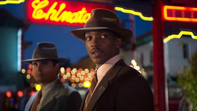 """This film image released by Warner Bros. Pictures shows Michael Pena, left, as Officer Navidad Ramirez and Anthony Mackie, as Officer Coleman Harris, in """"Gangster Squad."""" (AP Photo/Warner Bros. Pictures, Jamie Trueblood)"""