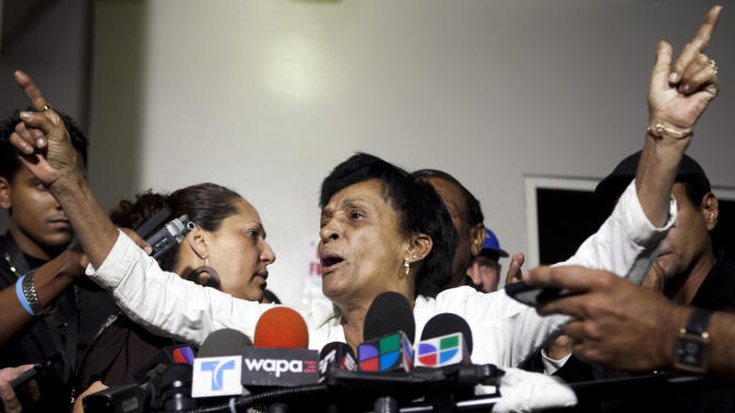 """Maria Matias, mother of former world boxing champion Hector """"Macho"""" Camacho, speaks with reporters outside Centro Medico trauma center in San Juan, Puerto Rico, Friday, Nov. 23, 2012. Camacho, who has been unconscious since he was shot in the face last Tuesday and declared brain dead by doctors, will be taken off life support on Saturday, his mother said in the brief news conference, a decision that the former championship boxer's eldest son opposes. (AP Photo/Dennis M. Rivera Pichardo)"""