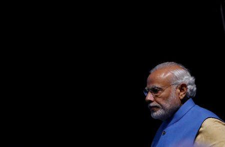 """India's Prime Minister Narendra Modi arrives to launch a digital payment app linked with a nationwide biometric database during the """"DigiDhan"""" fair, in New Delhi"""