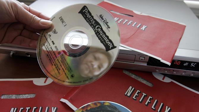 "FILE-In this Jan. 24, 2007 file photo, Netflix customer Carleen Ho holds up DVD movies, ""Talladega Nights"" and ""Pirates of the Caribbean' that she rented from Netflix, at her home in Palo Alto, Calif. Netflix said Wednesday, Jan. 23, 2013, that its Internet video service added 2 million U.S. subscribers during the final three months of the year to produce an unexpected profit for the company. Here's a breakdown of Netflix Inc.'s subscribers as of Dec. 31 and details on its forecast (AP Photo/Paul Sakuma, file)"