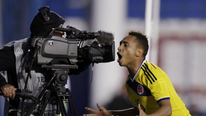 Colombia's Escalona celebrates after scoring a goal against Argentina during their match at the South American Under-20 Championship in Montevideo