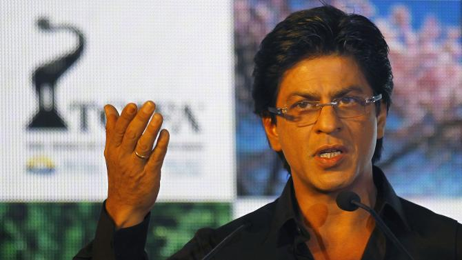Bollywood actor Shah Rukh Khan speaks during the unveiling of TOIFA Bollywood awards in Mumbai, India, Tuesday, Jan. 29, 2013. The award ceremony will take place in Vancouver in April. (AP Photo/Rafiq Maqbool)
