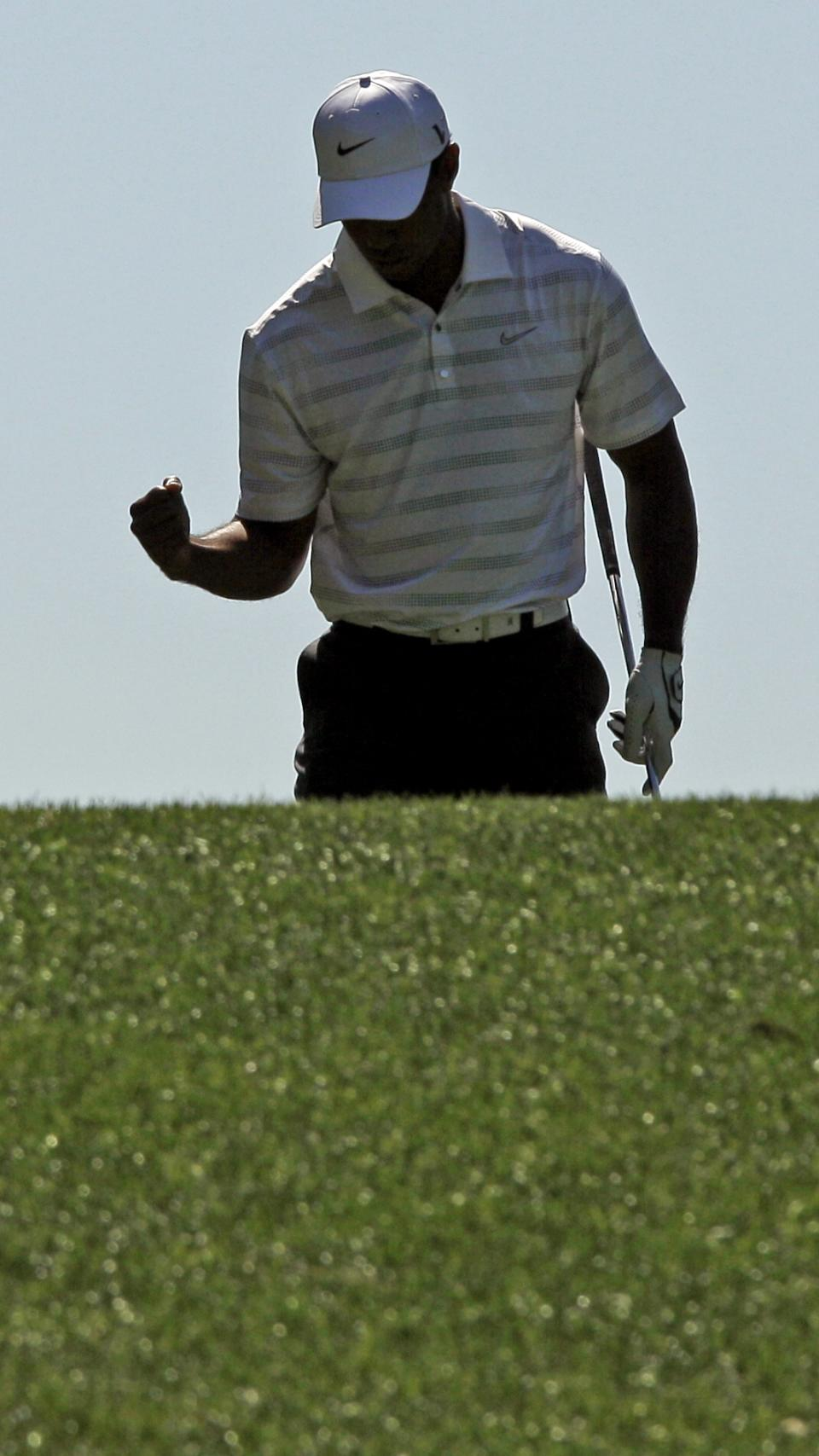 Tiger Woods pumps his fist after teeing off on the fourth hole during the third round of the Masters golf tournament Saturday, April 7, 2012, in Augusta, Ga. (AP Photo/Charlie Riedel)