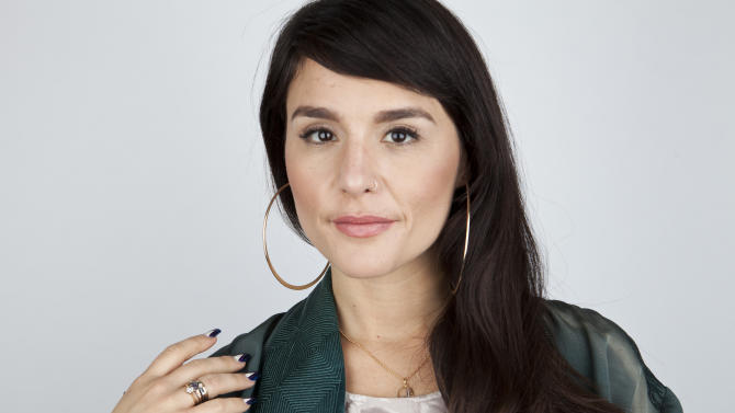 """In this April 2, 2013 photo, British singer-songwriter Jessie Ware poses for a portrait, in New York. In August Ware released her first album, """"Devotion,"""" in Europe, where it debuted at No. 5 and was nominated for the prestigious Mercury Prize. She's been buzzed about on the music blogs, and the album was released in America last week with two new tracks. (Photo by Amy Sussman/Invision/AP)"""