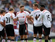 Liverpool's Steven Gerrard (3rd R) organises the wall during the match against Aston Villa on August 24, 2013. With Liverpool having secured victories in both of their matches so far, Manchester United trail Brendan Rodgers' side by two points going into Sunday's game