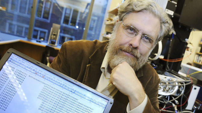 "FILE - In this Oct. 20, 2008 file photo, Harvard Medical School genetics professor George Church poses for a photo with DNA sequence data for Dr. John Halamka, chief information officer, following a news conference in Boston. Church says reports that made him sound like he was searching for a woman to bear a Neanderthal baby are based on misunderstandings of an interview he gave the German magazine Der Spiegel. Church said the idea of bringing back Neanderthals gets brief mention as a theoretical possibility in his recent book, ""Regenesis: How Synthetic Biology Will Reinvent Nature and Ourselves.''  (AP Photo/Lisa Poole, File)"