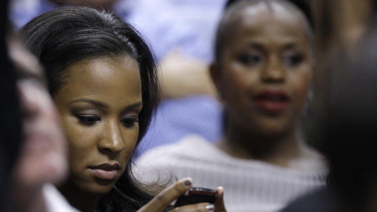 Savannah Brinson, the fiancee of Miami Heat's LeBron James, looks at her cell phone while watching an NBA basketball game between the Heat and the Atlanta Hawks, Monday, Jan. 2, 2012, in Miami. (AP Photo/Lynne Sladky)
