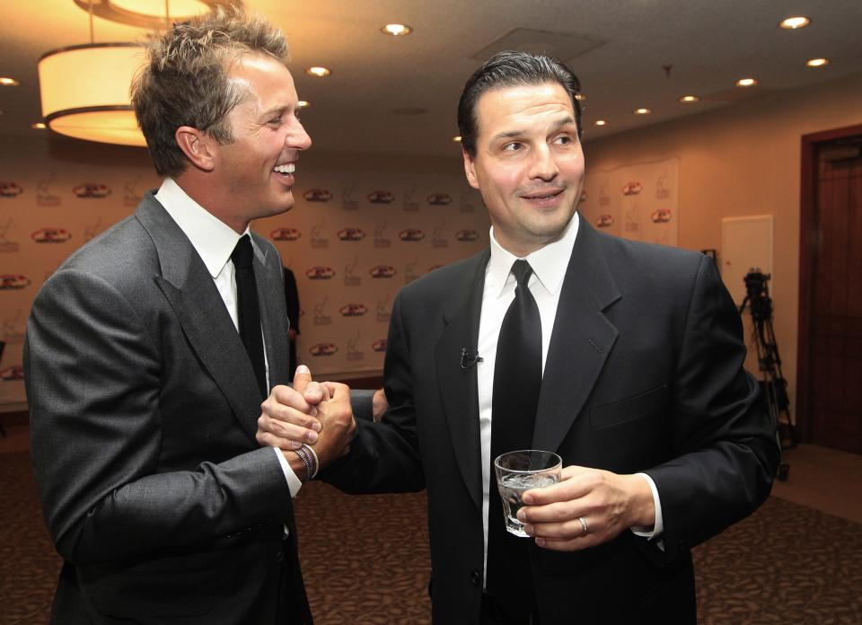 Hockey greats Eddie Olczyk, right, and Mike Modano shake hands and visit before the U.S. Hockey Hall of Fame class of 2012 induction dinner in Dallas, Monday, Oct. 15, 2012. (AP Photo/LM Otero)