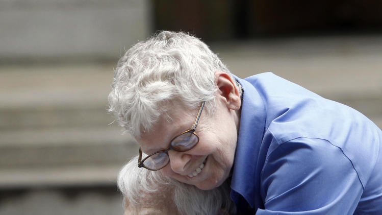 Phyllis Siegel, 77, right, and Connie Kopelov, 85, both of New York, embrace after becoming the first same-sex couple to get married at the Manhattan City Clerk's office, Sunday, July 24, 2011, in New York. (AP Photo/Jason DeCrow)