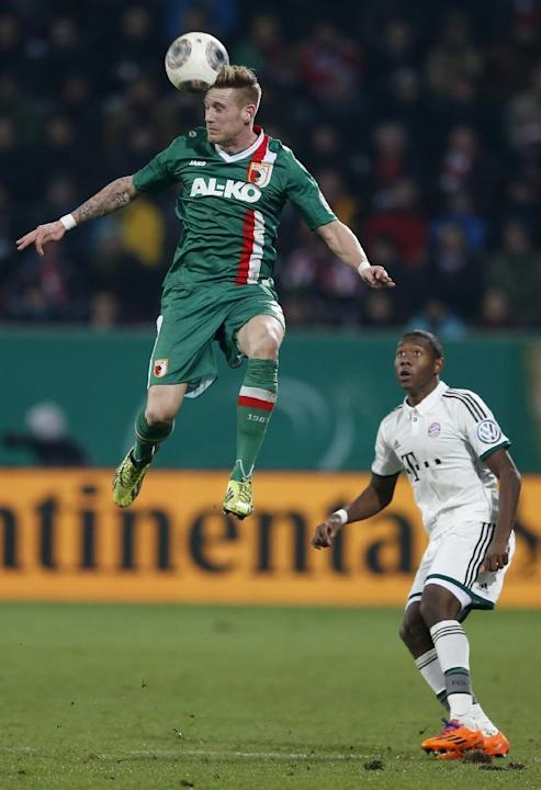 Augsburg's Andre Hahn goes for header besides Bayern's David Alaba of Austria during the German soccer cup third round match between FC Augsburg and FC Bayern Munich in Augsburg, southern Germ