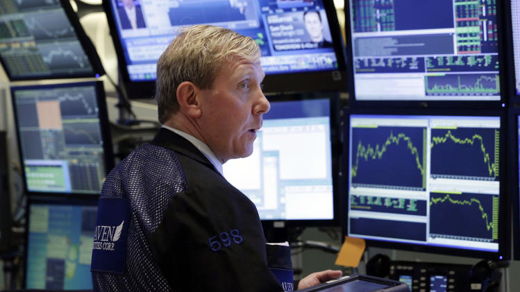 Trader Richard Cohen works in a booth on the floor of the New York Stock Exchange Monday, June 17, 2013. Stocks were up Monday because investors think Fed leaders will determine that the economy isn't recovering fast enough. (AP Photo/Richard Drew)