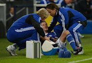 Schalke's midfielder Julian Draxler (C) receives treatment for an injury during their UEFA Champions League match on October 3. Schalke 04 will be without Draxler for up to four weeks after the 19-year-old needed an operation having fractured his left arm in the Champions League 2-2 draw with Montpellier