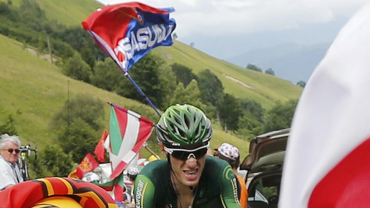 Europcar team rider Rolland of France climbs to Pla d'Adet in the Pyrenees mountains to win the 124.5km seventeenth stage of the Tour de France cycle race