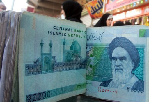File photo of Iranian rial banknotes bearing a portrait of the late founder of the Islamic Republic of Iran, Ayatollah Ruhollah Khomeini. Beijing reacted furiously Wednesday to new US sanctions