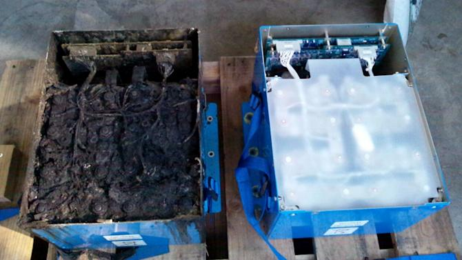 FILE - This Jan. 17, 2013 file photo provided by the Japan Transport Safety Board shows the distorted main lithium-ion battery, left, and an undamaged auxiliary battery of the All Nippon Airways' Boeing 787 which made an emergency landing on Jan. 16, 2013 at Takamatsu airport in Takamatsu, western Japan. A probe into the overheating of the lithium ion battery in the All Nippon Airways Boeing 787 found it was improperly wired, Japan's Transport Ministry said Wednesday, Feb. 20, 2013. (AP Photo/Japan Transport Safety Board, File) EDITORIAL USE ONLY, NO SALES