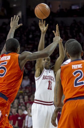 Powell leads Arkansas by Auburn 88-80 in double OT