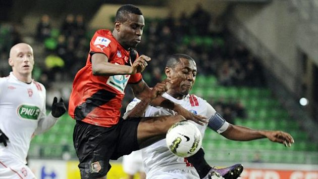 Rennes striker Razak Boukari (L) fights for the ball with Nancy defender Andre Luis Silva do Nascimento