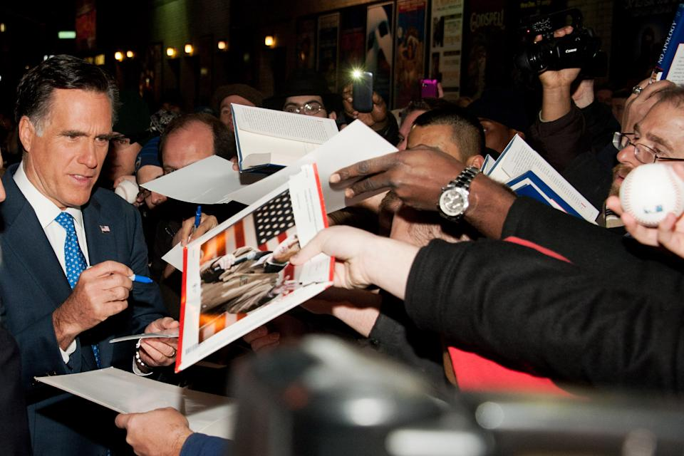 "Republican presidential candidate Mitt Romney signs autographs after taping an episode of the ""Late Show with David Letterman,"" in New York, Monday, Dec. 19, 2011. (AP Photo/Charles Sykes)"