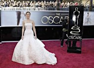 "Best Actress nominee Jennifer Lawrence for her role in ""Silver Linings Playbook"" arrives at the 85th Academy Awards in Hollywood, California February 24, 2013. REUTERS/Lucas Jackson"