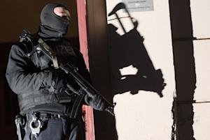 Special police force guards the entrance of a house…